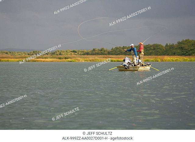 Anglers fly fishing from a boat in Bristol Bay near Crystal Creek Lodge, King Salmon, Southwest Alaska, Summer