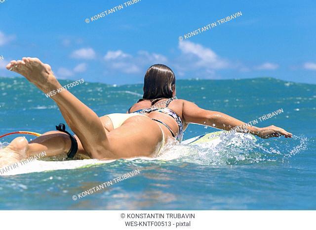 Indonesia, Bali, female surfer