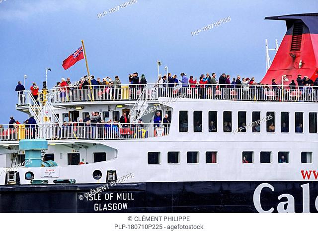 Passengers on deck of the Caledonian MacBrayne ferry boat Isle of Mull / An t-Eilean Muileach leaving the port of Oban