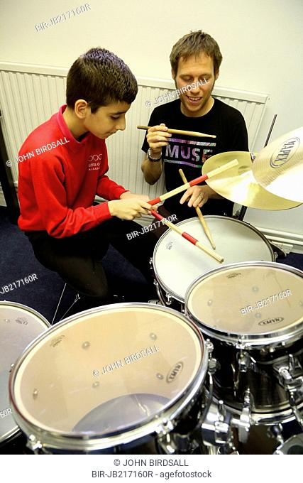 Visually impaired boy being given drumming lessons at My Sight charity, Nottingham