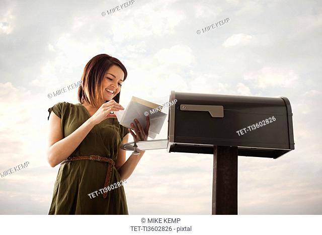 Young woman at mailbox