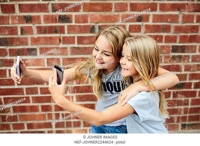 Happy girls taking selfie