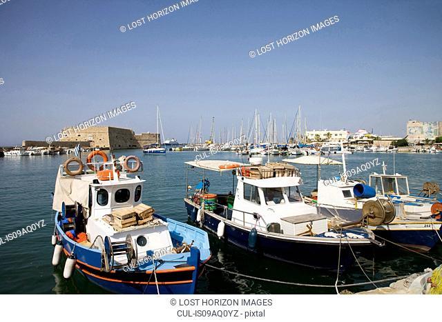 Fishing boats moored in harbor, Mykonos, Cyclades, Greece