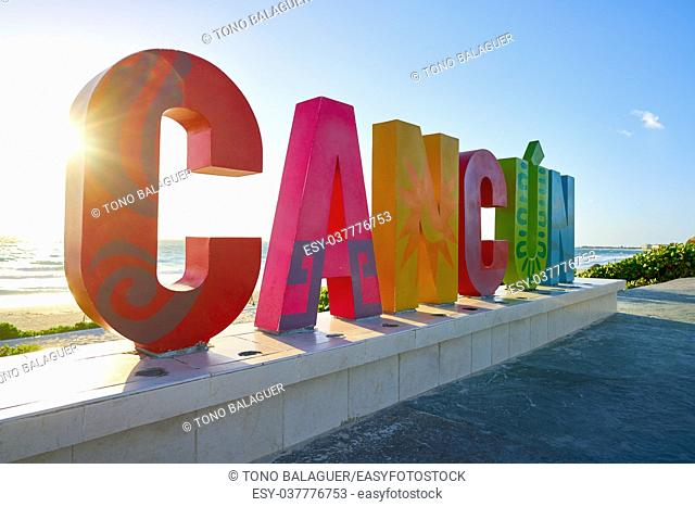 Cancun word sign at Delfines Beach sunrise in Mexico