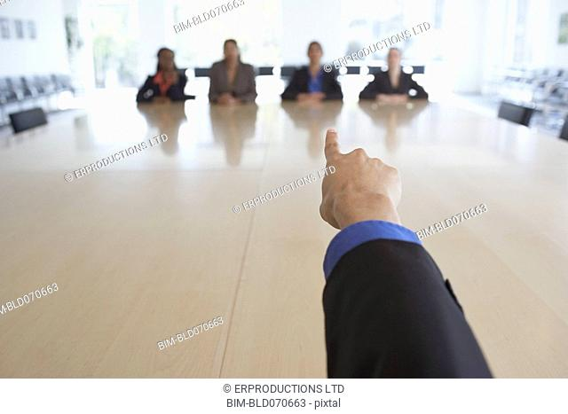 Businessman pointing at co-workers