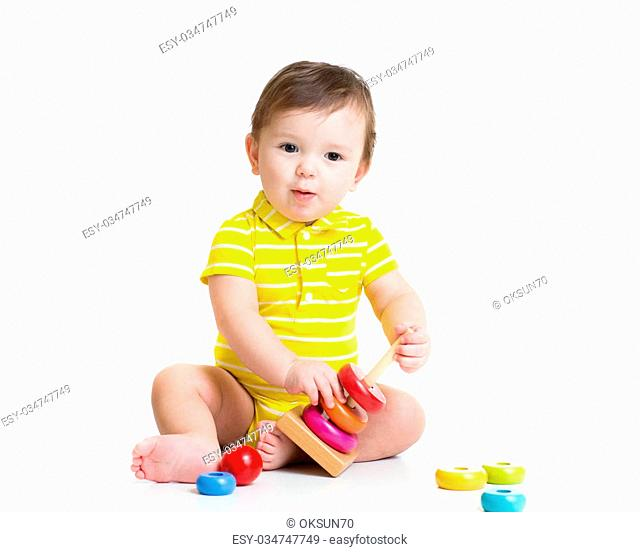 baby boy playing with colorful toy pyramid