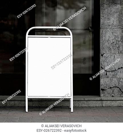 Blank street poster - clamshell in white painted steel frame. Clipping path