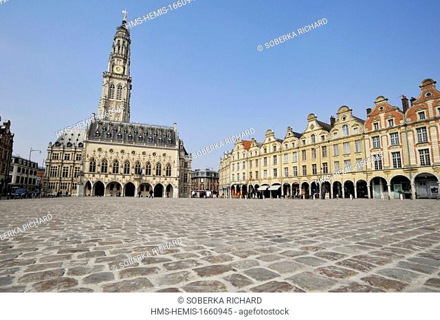 France, Pas de Calais, Arras, Place des Heros, cobblestones in front of Town Hall topped with its 77 meters belfry listed as World Heritage by UNESCO