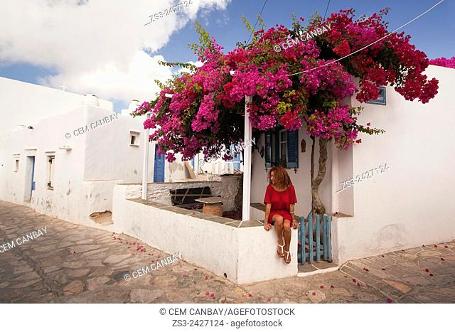 Woman in front of the Cyclades house in Artemonas village, Sifnos, Cyclades Islands, Greek Islands, Greece, Europe