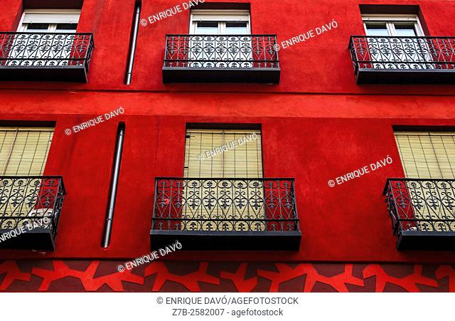 A red front of a building in a central street of Madrid city, Spain