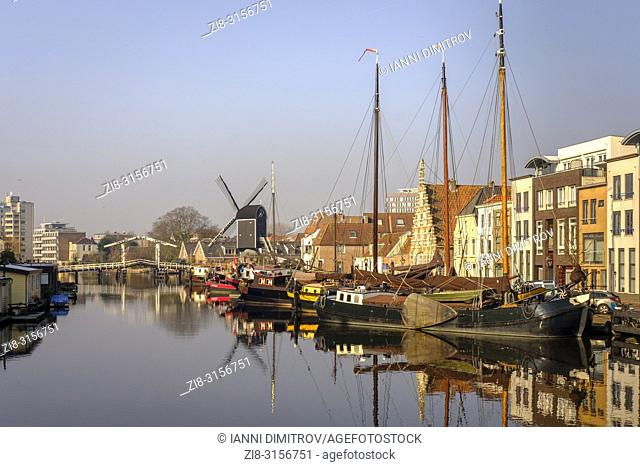 Netherlands,Leiden- -view of the old town with the Molen De Valk-windmill with a working waterwheel and 1900s-style living spaces
