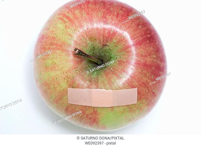 elevated view of apple with band aid