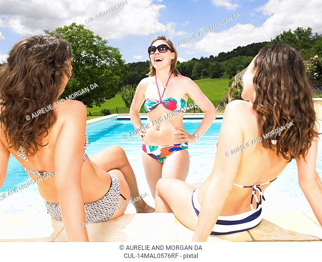 young women gossiping in pool