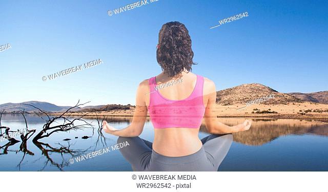 Double exposure of woman meditating at lakeshore
