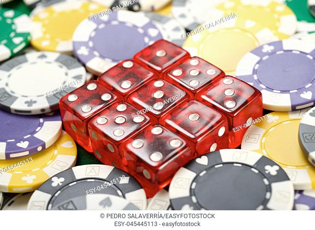 casino chips and dices on a green felt