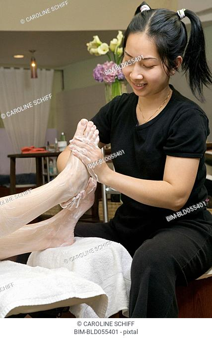 Asian spa technician giving massage