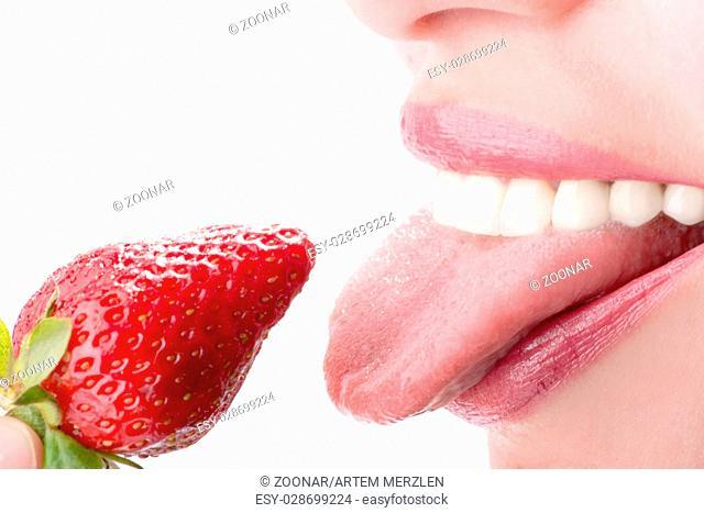 woman eat strawberry