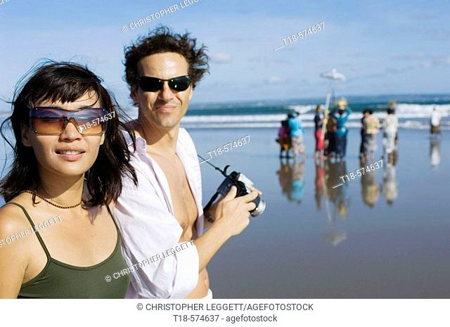 couple holidaying and taking snapshot on beach