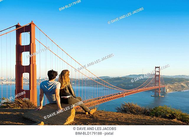 Hispanic couple admiring Golden Gate Bridge, San Francisco, California, United States