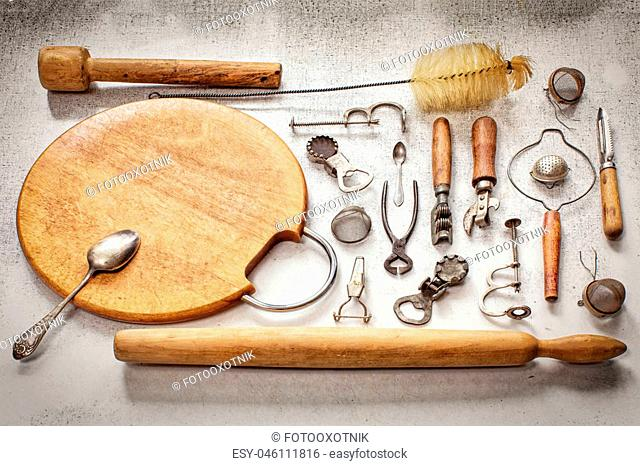 Old pieces of kitchen utensils on a table the top view