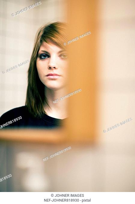 Teenage girl in front of a mirror, Sweden