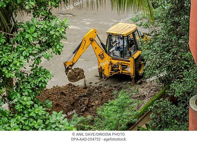 Jcb excavators on road, kalyan, thane, maharashtra, india, asia