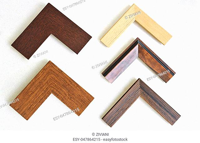 wooden triangles frames on white background