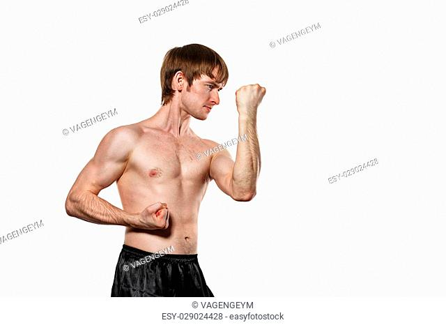 The man trains kata kung fu block the blow. Isolated on white background. The concept of masculine strength and a healthy lifestyle