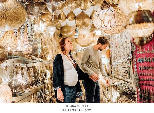 Pregnant couple in souk, Marrakech, Morocco
