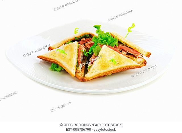 Sandwiches with chicken, bacon and vegetables isolated on white plate. Closeup