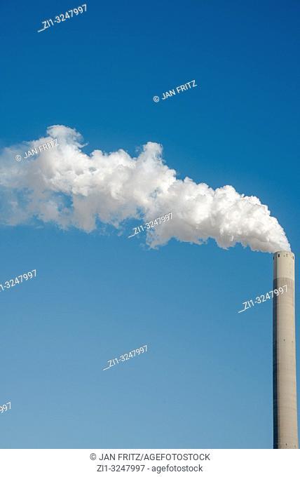 smoking pipe from powerplant and blue sky