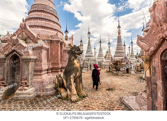 Kakku, Taunggyi, Shan State, Myanmar (Birmania). A woman walking between the 2478 stupas