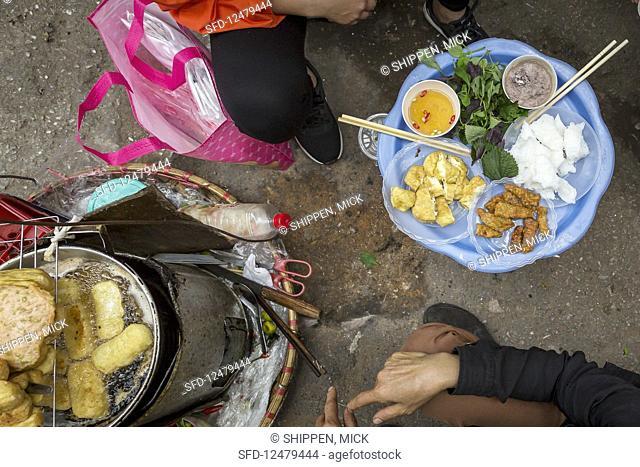 Deep fried tofu in a street kitchen in Hanoi (Vietnam)