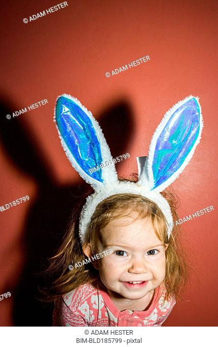 Caucasian baby girl wearing bunny ears