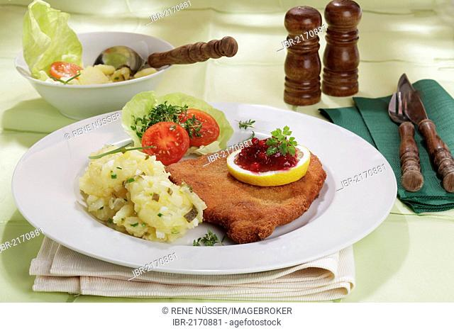 Viennese Schnitzel with lemon and cranberries, potato salad