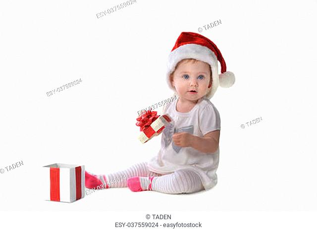 adorable baby girl in Santa hat with gift box
