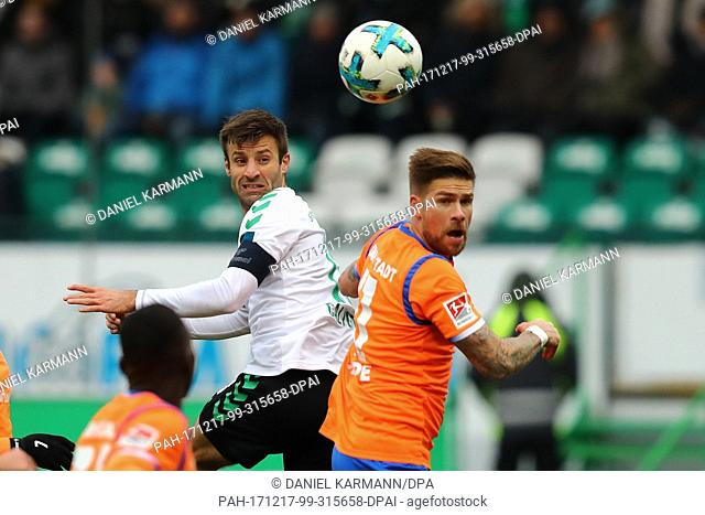 SpVgg Greuther Furth's Marco Caligiuri (L) and SV Darmstadt 98's Tobias Kempe vying for the ball during the German 2nd Bundesliga soccer match between SpVgg...