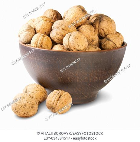Walnuts In A Clay Bowl Isolated On White Background