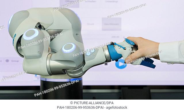 Micha Purucker from the company Festo presents an intelligent robot arm, which is designed according to the human arm, during a press conference at the fair in...