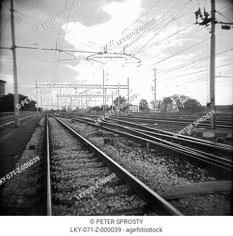 Train tracks with conductors over top