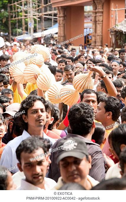 Crowd at a religious procession during Ganpati visarjan ceremony, Mumbai, Maharashtra, India