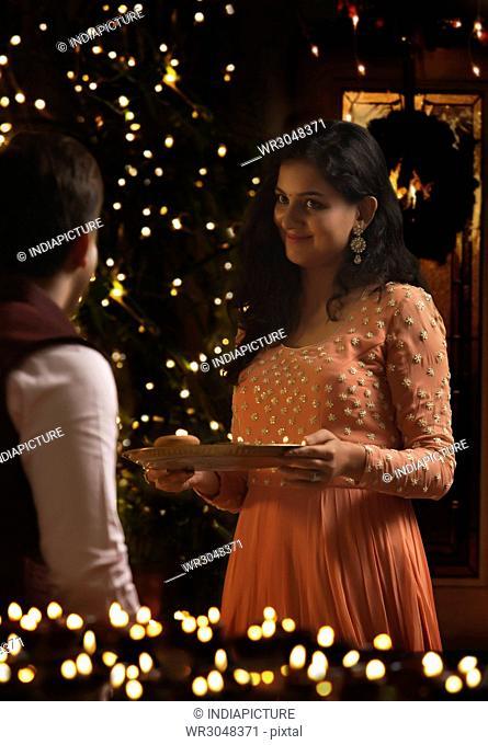 Young couple celebrating diwali