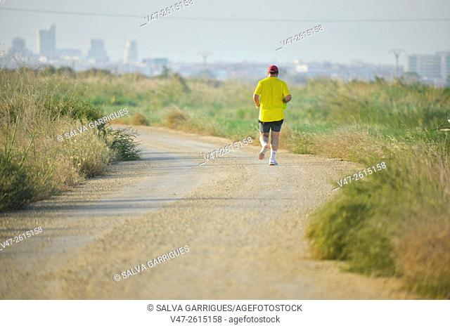 Man exercising on the outskirts of Valencia, Albufera, Silla, Catarroja, Spain, Europe