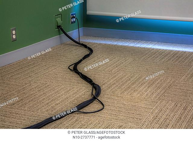 Electrical cables on the floor of a classroom