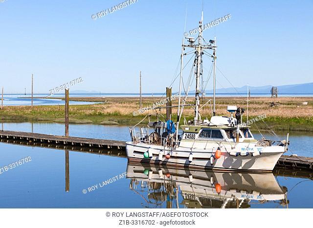 Fishing vessel tied up alongside a floating pontoon in Steveston British Columbia
