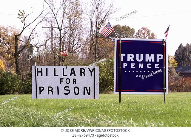 A Trump - Pence sign along with a Hilary for prison sign on the from lawn of a house near Morris, Illinois. Echoes of Trump's rally cry of lock her up