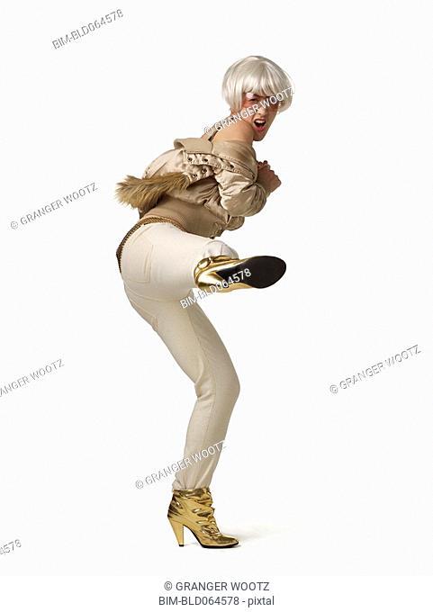Glamorous Asian woman kicking