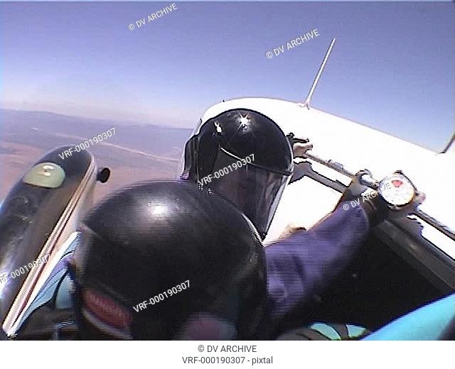 Skydivers leap out of a plane and perform tricks and patterns during free fall