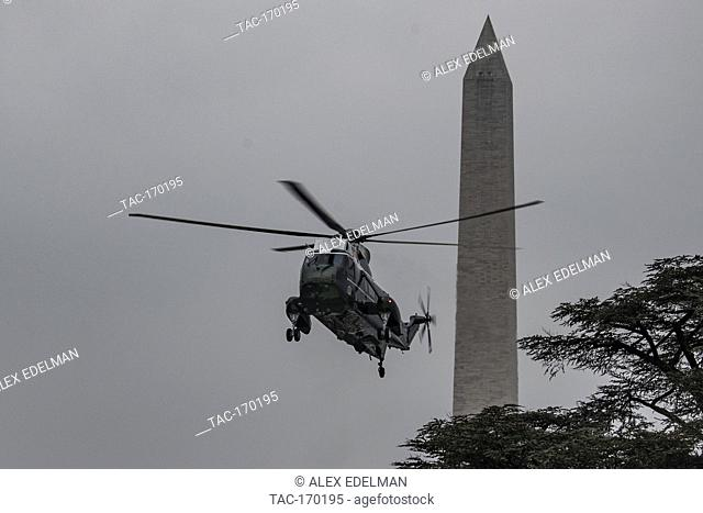 Marine One carrying US President Donald Trump prepares to land on the South Lawn of the White House in Washington, DC on January 19, 2019