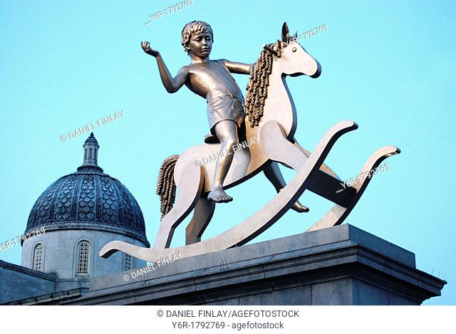 Piece of contemporary art entitled 'Powerless Structures' in evening light on the fourth plinth in Trafalgar Square, London, England